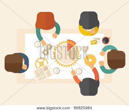 A meeting  of a business people sitting facing each other in the office with coffee and papers on th