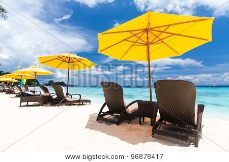Sun Umbrella And Beach Beds On  Beach
