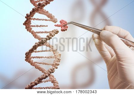 Genetic engineering and gene manipulation concept. Hand is replacing part of a DNA molecule.
