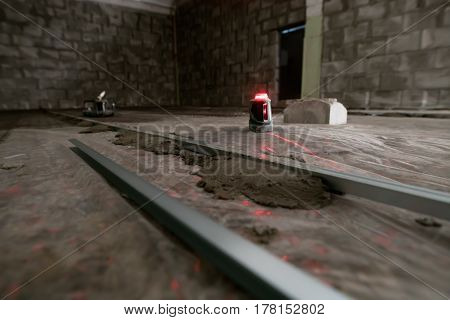 Electronic floor flatness meter with red light in studio being repaired stock photo
