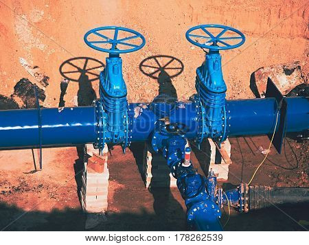 Construction of main City water supply pipeline. 500mm large water pipeline with gate valves 250mm branch. Pipes joined with new blue Gate valves and new black waga multi joint members. stock photo