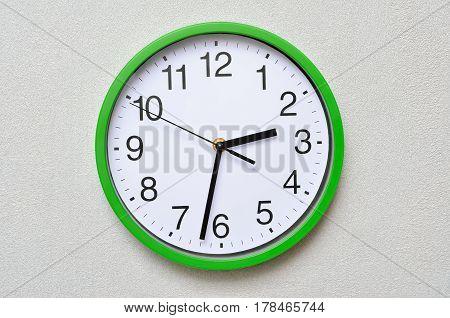 Large wall analog clock isolated on white background. stock photo