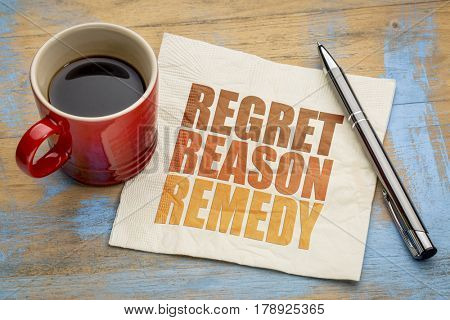 Regret, reason, remedy word abstract on a napkin with a cup of coffee - crisis management concept stock photo