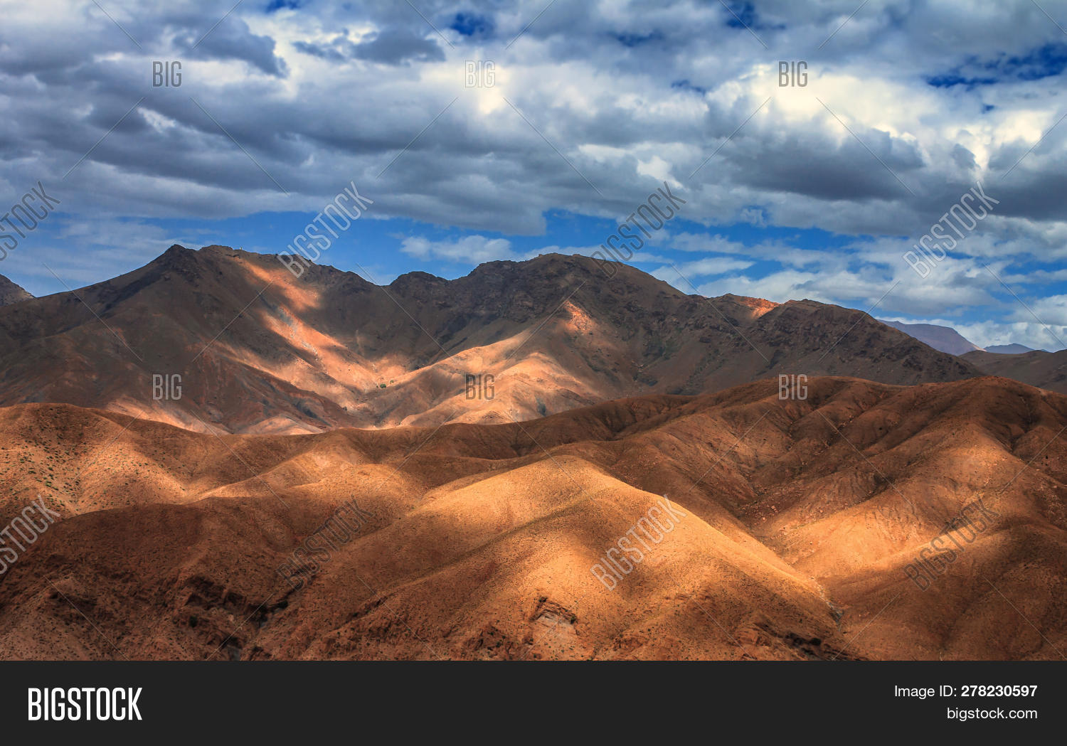 Amazing View Of Sandy Desert At High Atlas Mountains Range. Moroccan Landscapes With Bright Sun And