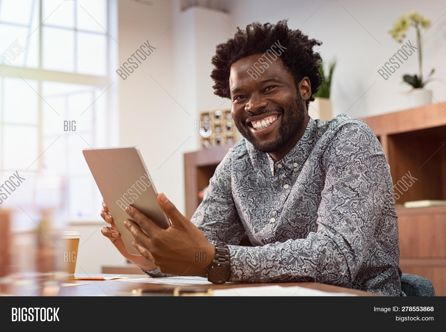 30s,african,african american,american,black,black man,business,business casual,business man,businessman,casual,casual business,checking,cheerful,co working,communication,computer,confident,connection,creative office,desk,digital,digital tablet,electronic,happy,holding,internet,looking,looking at camera,mature,mid adult man,modern office,network,office,people,portrait,reliability,sitting,smart casual,smile,successful businessman,tablet,technology,toothy smile,using,using digital tablet,wireless,work,young,young man