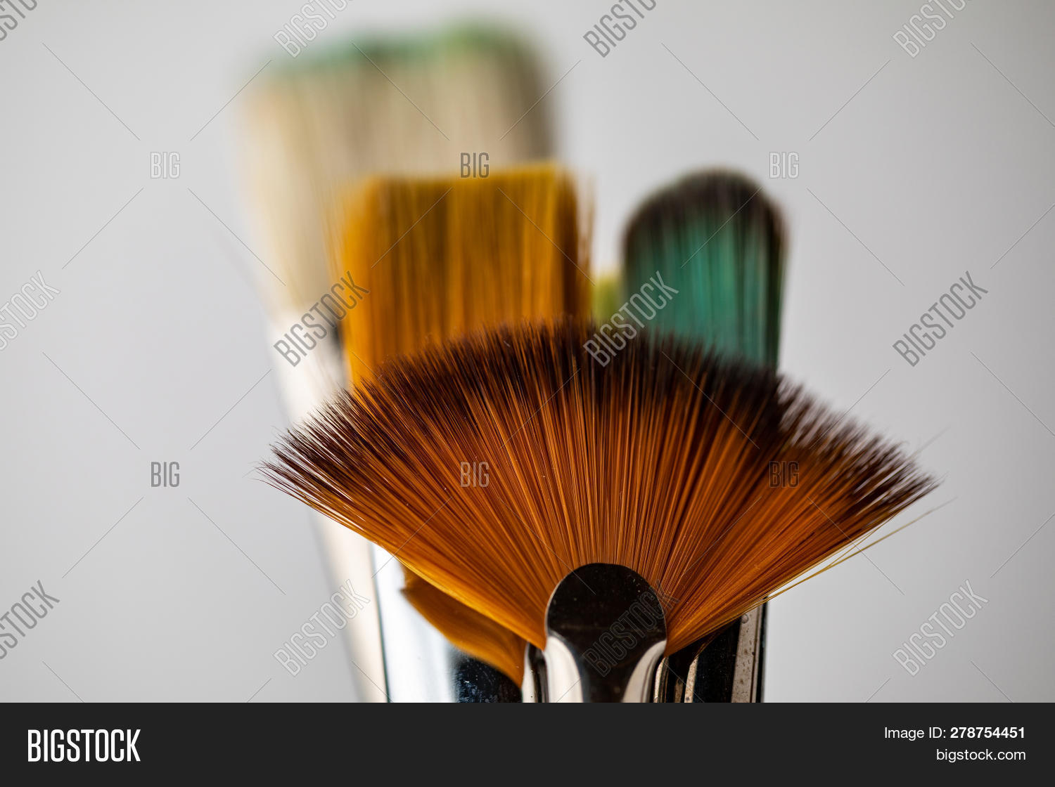 Several Multi-colored Artistic Brushes. Closeup Of Artistic Brushes