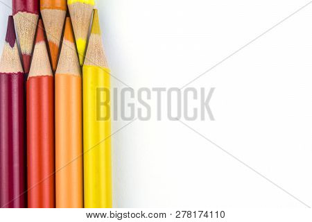 Red, orange and yellow pencils on white background stock photo