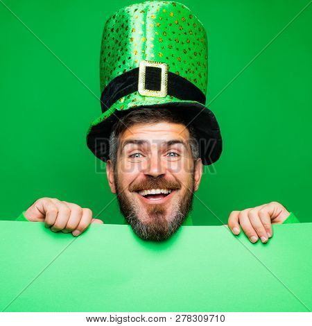 Lucky Patricks day. Man on green background celebrate St Patricks Day. Man in Saint Patricks Day leprechaun party hat having fun on green background. Copy space stock photo
