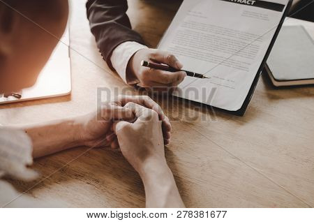 legal consultants, notary or justice lawyer discussing contract document on desk with client customer in courtroom office, business, justice law, insurance, legal service, buy and sell house concept stock photo