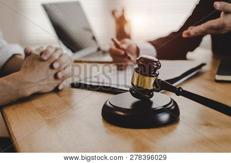legal consultants, notary or justice lawyer discussing contract document with customer and wooden judge gavel on desk in courtroom office, business, justice law, insurance and legal service concept stock photo