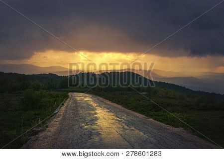 Sunset in mountain landscape. Lonely road in mountain nature. Nature. Road. Natural environment. Mountain landscape nature. Road in nature. Nature environment, Travel in nature.Last sunlight in mountain landscape. stock photo