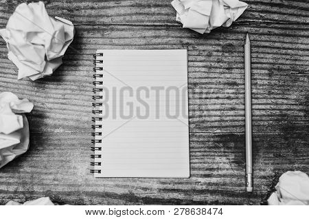 Minimalist Desk Setting Flatlay With Opened Ruled Notepad And Pencil Surrounded By Scrunched Paper B