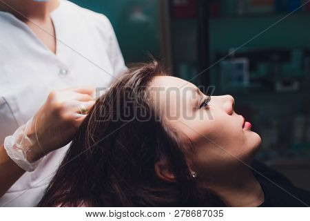 Platelet rich plasma injection procedure. Hair growth stimulation. PRP therapy process. stock photo