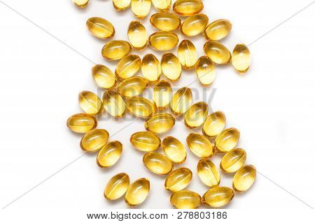 Close up of food supplement oil filled capsules suitable for: fish oil, omega 3, omega 6, omega 9, evening primrose, borage oil, flax seeds oil, vitamin A, vitamin D, vitamin D3, vitamin E. stock photo