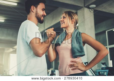 Attractive Young Couple Handshaking After Workout In Fitness Gym., Portrait Of Man And Woman Couple
