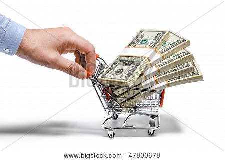 businessman's hand & steel grocery cart full of money stacks - isolated on white background