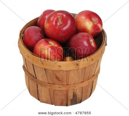 Red apples filling basket isolated on white stock photo