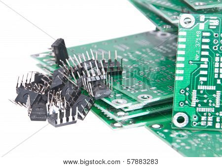 PCBs with different electronic components isolated on white background stock photo