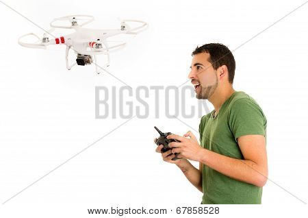 handsome young man with quadcopter drone isolated on white stock photo