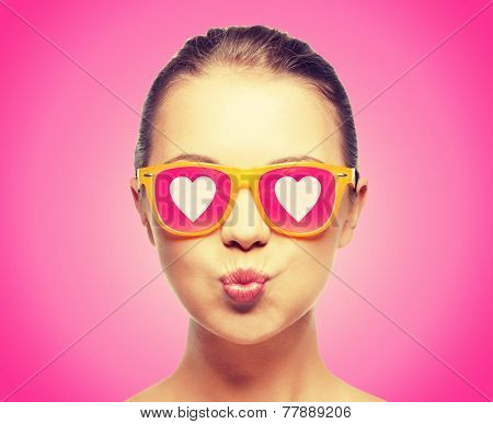 love, happiness, valentines day, face expressions and people concept - portrait of teenage girl in p