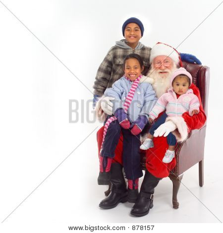 santa sitting with children on his lap; white background stock photo