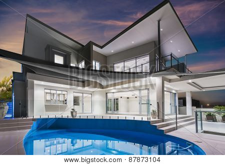 Mansion With Pool And Beautiful Sky At Dusk
