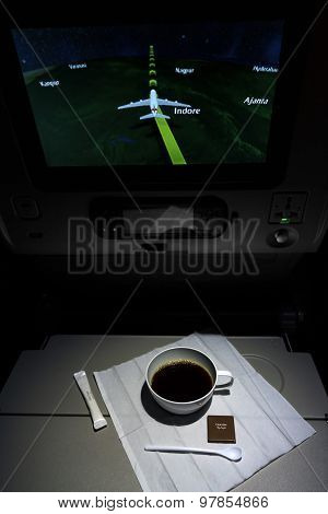 Modern airplane comfortable compartment interior and cup of coffee on table stock photo