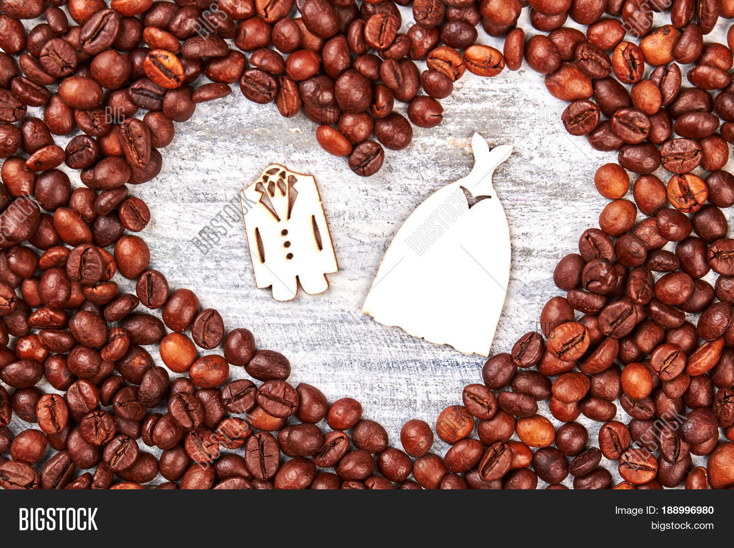 accessory,arabica,aroma,aromatic,background,bean,beverage,black,breakfast,brown,cafe,caffeine,cappuccino,cardboard,celebration,closeup,coffee,dark,decoration,dress,drink,energy,espresso,figure,food,frame,fresh,freshness,gourmet,grain,heart,ingredient,love,marrige,morning,natural,restaurant,retro,roast,roasted,romantic,seed,shape,space,style,symbol,texture,tuxedo,valentine,wooden