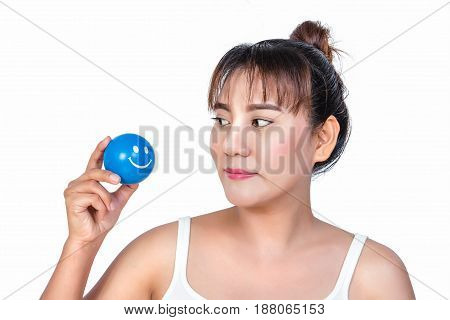 asian woman with smiley face stress ball stock photo