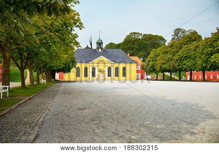 The church and adjacent prison in Kastellet Copenhagen. The Church at the Citadel was built in 1704 in heavy Baroque style. stock photo