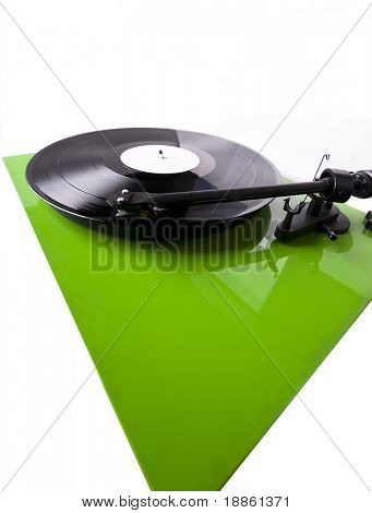 Green turntable playing a record isolated on white. Wide angle shot stock photo