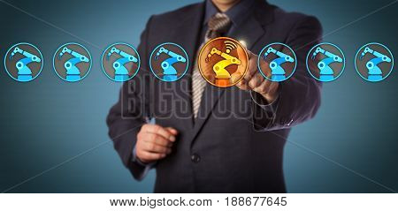 Blue chip engineer selecting the only wireless connected robotic arm in a lineup of eight industrial robots. Concept for industry 4.0 internet of things smart factory and technical assistance. stock photo