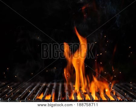 Empty flaming charcoal grill with open fire, ready for product placement. Concept of summer grilling