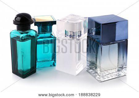 Bottles of modern male perfume on white background stock photo