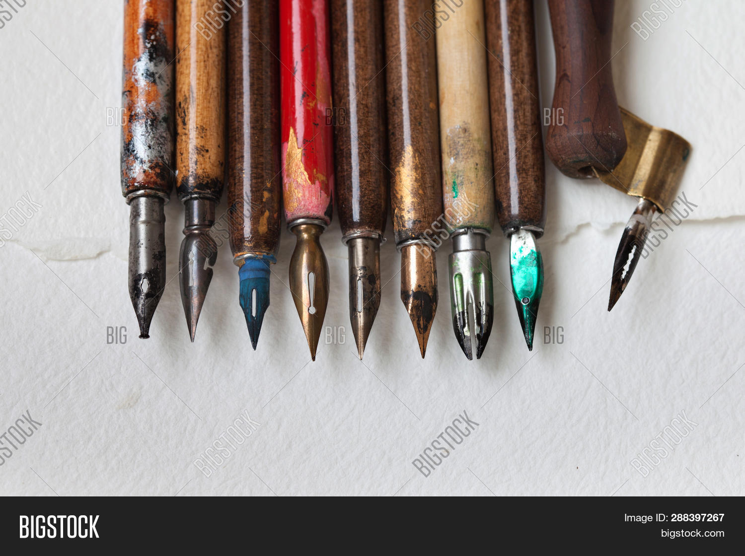 accessories,ancient,antique,art,artist,artistic,background,business,calligraphic,calligraphy,classic,closeup,collection,color,colorful,communication,creative,design,different,draw,elements,equipment,fountain,frame,handwriting,history,ink,letter,macro,metal,nib,office,old,paper,pen,retro,school,set,signature,stainless,steel,steel-nib,texture,tool,vintage,wooden,workshop,write
