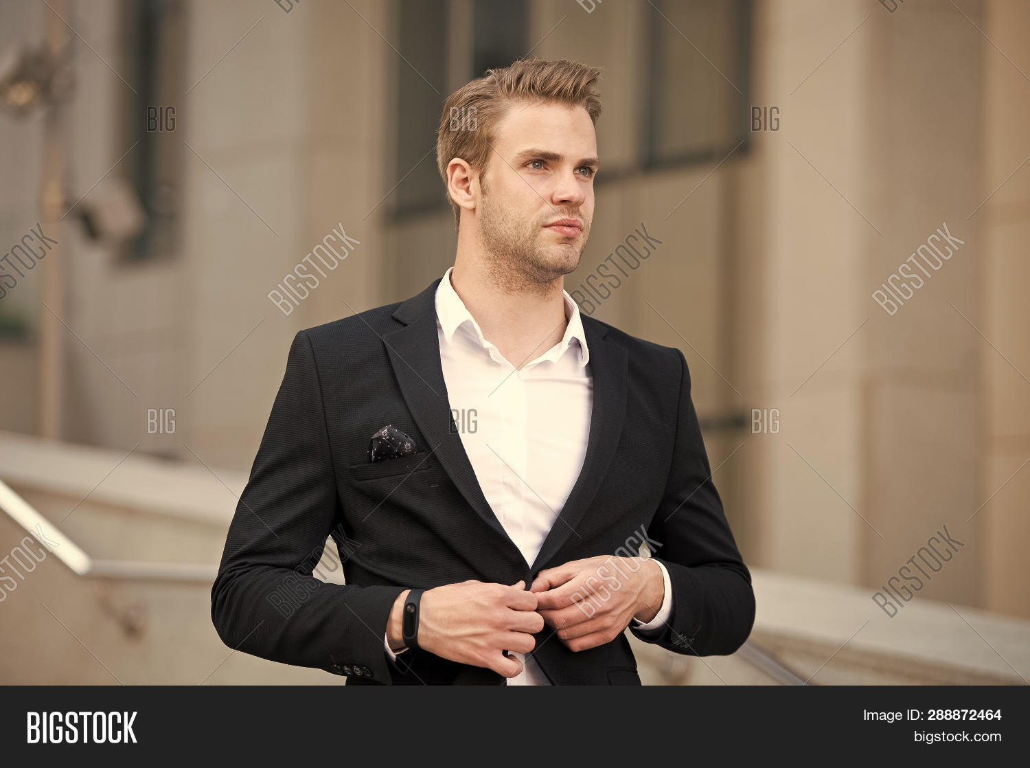 appearance,attire,attractive,background,business,businessman,clothes,clothing,concentrated,confident,culture,decorum,defocused,dress,environments,fashion,fashionable,formal,garment,groomed,guy,hairstyle,handsome,look,man,menswear,modern,organization,outdoor,outfit,professional,professionalism,sharp,shirt,style,stylish,successful,suit,uniform,urban,wardrobe,wear,well,woven,young