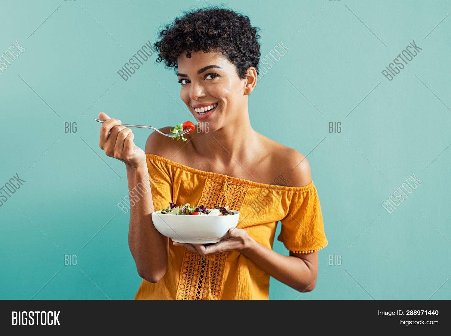 20 years,20 years old,african,african american,african american woman,african woman isolated,american,background,beautiful,black,bowl,brazilian,brazilian woman,carefree,casual,cheerful,copy space,diet,diet food,diet woman,dieting,eat,eating salad,food,fork,fresh,freshness,girl,happy,healthy,healthy food,isolated,lettuce,light blue background,looking at camera,meal,nutrition,one,people,portrait,salad,salad bowl,smile,summer eat,tomato,toothy smile,vegetable,vegetarian,weight,young