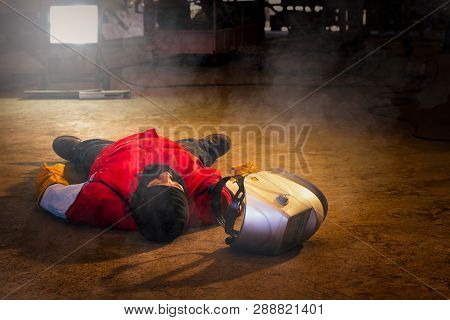 First aid training in the factory industrial. Welder accident in works and fainting in a factory industrial. Safety and protection equipment in works of the construction industry. stock photo