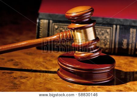 the judge hammer a judge in court. located on a desk. stock photo