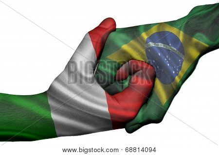 Diplomatic handshake between countries: flags of Italy and Brazil overprinted the two hands stock photo