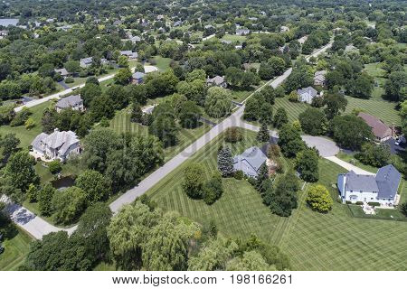 Aerial view of a luxury neighborhood with mature trees and large lots in a Chicago suburban neighborhood in summer. stock photo