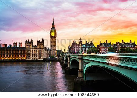 London, UK. Sunset over the city of London, UK. Colorful sky behind Westminster and Big Ben. Westminster bridge at night