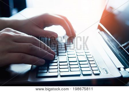 Male Hands On A Laptop Keyboard