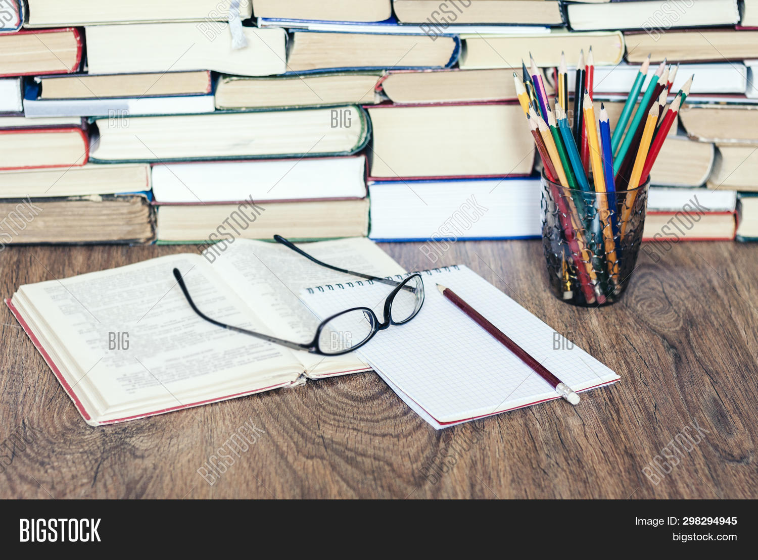 Stack Of Books, Hardback Books On Wooden Table, Open Book, Notebook And Glasses, Copy Space For Text