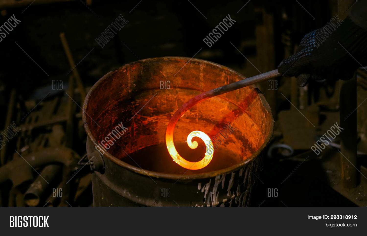 art,authentic,blacksmith,bright,bucket,chill,closeup,concept,cooling,craft,detail,element,equipment,farrier,fire,forge,glowing,hand,handmade,handwork,heat,hot,industry,iron,ironwork,make,manual,manufacture,manufacturing,melting,metal,metalwork,molten,occupation,quench,revival,skill,smith,smithery,smithy,smoke,solid,steam,steel,temperature,traditional,vapor,water,workshop