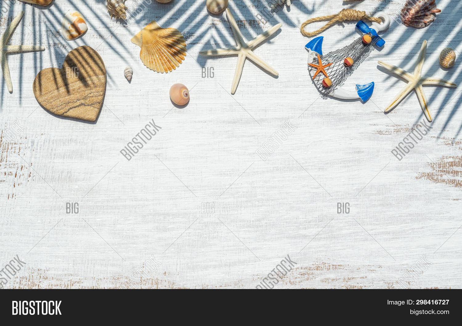 Flat Lay Of Sea Shells, Starfish And Palm Leaf Shadow On Grunge White Wooden Background. Background