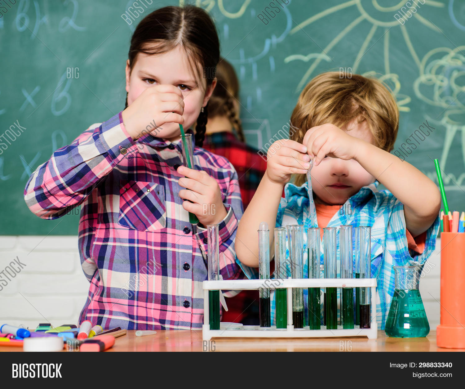 Teacher And Pupils Test Tubes In Classroom. Chemistry Themed Club. Discover And Explore Properties O