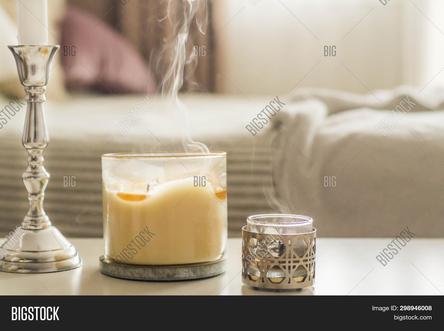 A Lot Of Candles With Candlesticks On The Home Background. Home And Home Decor. Candles Flame. Home