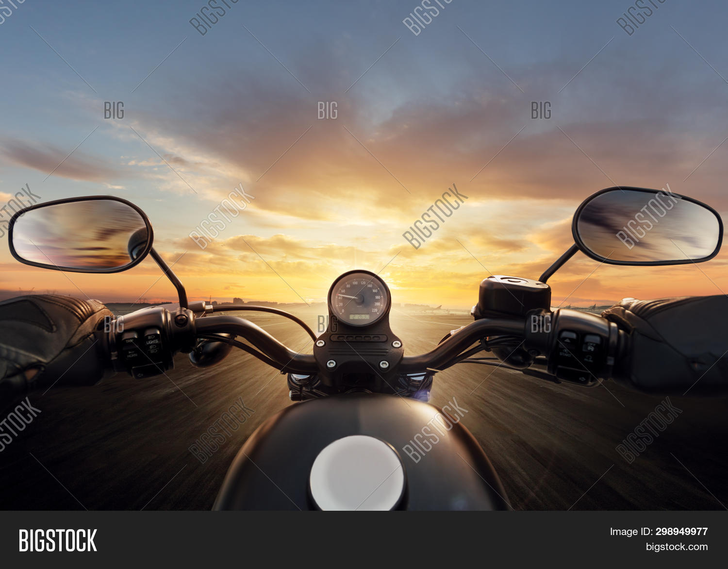 POV of motorcycle driver with handlebars. Outdoor photography. Travel and sport, speed and freedom c