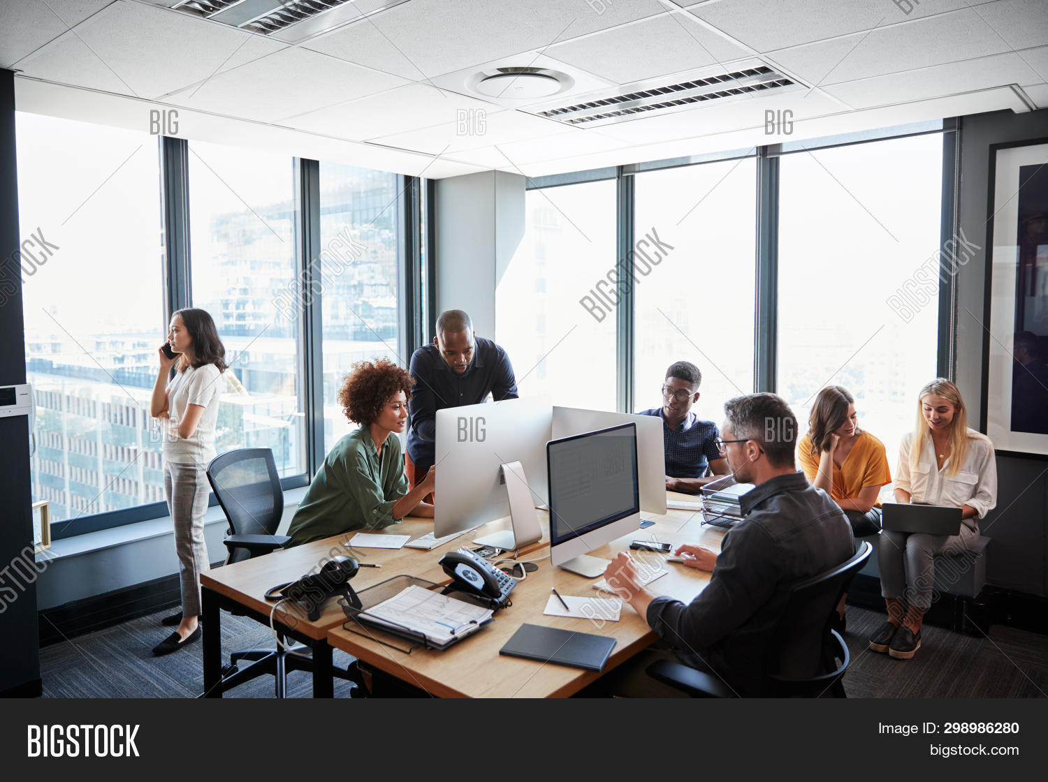 Creative business team working together in a busy casual office